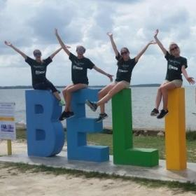 Projects Abroad volunteers take a break by the Belize sign during their volunteer work in Belize.